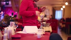 Male hands put embers to hookah in restaurant About movies Stock Footage