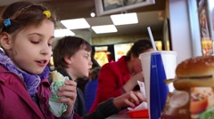 Handsome boy, girl and mother have snack at restaurant KFC Stock Footage