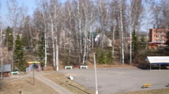 Above view of park with paths, pond at sunny spring day Stock Footage