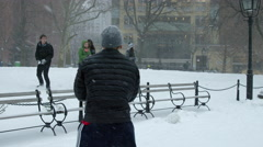 Throwing snowballs snowball fight Washington Square Manhattan 4K slow motion NYC Stock Footage