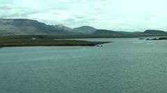 Iceland city of Reykjavik 037 shore with Icelandic mountain landscape behind Stock Footage