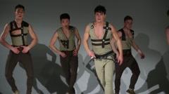 Five beautiful men in hunting medieval costumes dance in studio Stock Footage