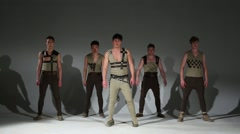 Stock Video Footage of Five graceful men in hunting medieval costumes dance in studio