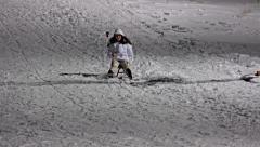 4k Kid sledding on night winter, girl run and fall down on snow. UHD stock vi Stock Footage