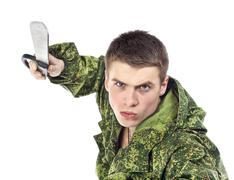 Military Man Attack With Knife - stock photo