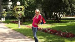Stock Video Footage of Blonde Young Woman After Shopping
