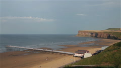 LONG PIER BEACH & NORTH SEA, SALTBURN-BY-THE-SEA, NORTH YORKSHIRE, ENGLAND Stock Footage
