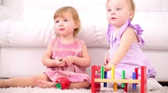 Two happy kids play with wooden toys for development of thinking Stock Footage
