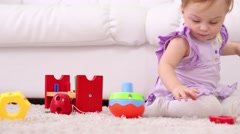 Little cute girl plays with toy for development of thinking - stock footage