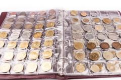 Coin album with world coins - stock photo