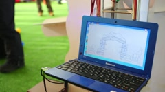 Boy plays Interactive Electronics MI-02 game and screen of laptop Stock Footage