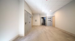 Empty light hall with grey doors in residential building Stock Footage