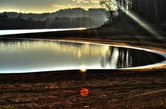 Sunbeam at the lake - stock photo