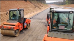 Special rolls machinery in construction of new highway Stock Footage