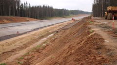 Construction site of highway in forest with many sand and gravel Stock Footage