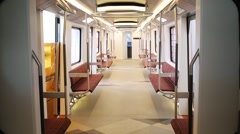 New empty and comfort wagon with red seats of underground train Stock Footage
