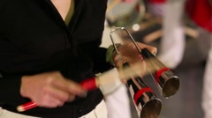 Female hands playing on percussion instruments on stage Stock Footage