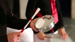 Male hands playing on small hand white drum on stage Stock Footage