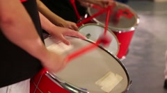 Hands of three musicians with sticks playing on drums on stage Stock Footage