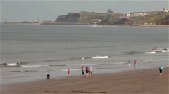 BEACH SCENE & WHITBY, SANDSEND, NORTH YORKSHIRE, ENGLAND Stock Footage