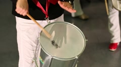 Male hands playing on white drum on stage at concert Stock Footage