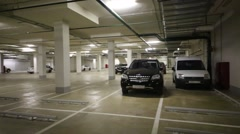 New modern indoor parking for many cars in residential complex Stock Footage