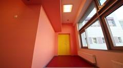 Turn off lights in small orange room in kindergarten Stock Footage