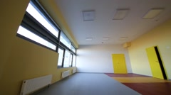 Turn on lights in playroom with yellow walls in kindergarten Stock Footage