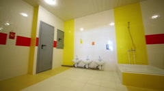 washroom with children washbasins and toilets in kindergarten - stock footage