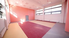 Room for sport with orange walls and large windows in kindergarten Stock Footage