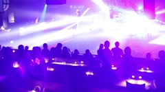 Laser show and silhouettes of people in night club Stock Footage