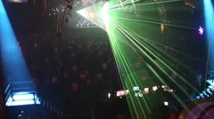 Top view of laser show and dancing people in night club Stock Footage