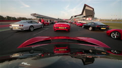 FERRARI'S WAITING PARADE, SILVERSTONE RACE, TRACK, ENGLAND Stock Footage