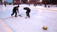 Curlers throw stones for curling on ice. Stock Footage