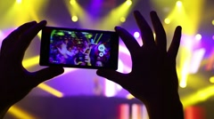 Hands of man holding touchscreen phone shoot party - stock footage