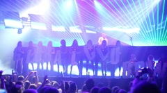 Showgirls with letters GLOBALCLUBBING in Stadium Live Stock Footage