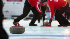 Players curling throw stones on the ice. Stock Footage