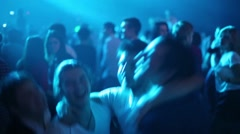 Young people throw friend at Global Clubbing Mind Games Stock Footage