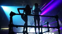 Back of two showgirls dancing on Global Clubbing Mind Games Stock Footage