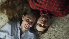 Happy Smiling Young Couple Laying on The Floor. Top view. Casual Lifestyle. Stock Footage