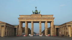 Brandenburg gate (Brandenburger Tor) in Berlin, Germany at sunrise Stock Footage