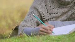 Writing in diary Stock Footage