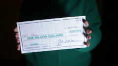 Holding giant check lottery lotto Stock Footage