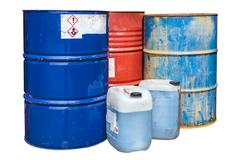 Toxic waste barrels isolated on white Stock Photos