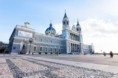 Cathedral Almudena with tourists on a spring day in Madrid - stock photo