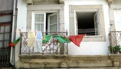 Portuguese flag on balcony in Porto, Portugal Stock Footage