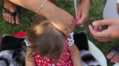 Rite of cutting hair of child Stock Footage