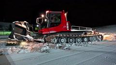 4k Mountain Ratrak Making Ski Piste. UHD steadycam stock video Stock Footage