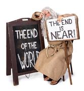 Unhappy visionary with a sign of the end of the world Stock Photos