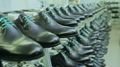 Manufacturing process in shoe factory - stock footage
